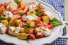 Peach, Burrata, and Prosciutto Panzanella Salad   behind the plates