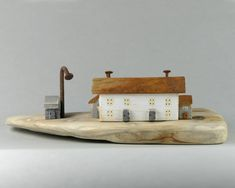 It looks like a rusty roof on this country cottage but its just the colour of the wood, the chimneys are rusty tho, nails and so is the lampost and for fun we added a little shed. Handmade by us in North Norfolk not far from the Sea, this is unique and original using proper British