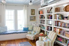 this set up would work perfectly for my dining room to library conversion - the window seat would be great