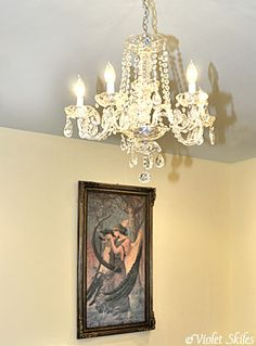 Chandelier just like the one my sweet nana is giving me for kelby's room, i feel like it may be as big as her whole room though lol