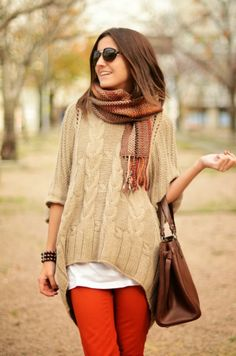 Orange skinny jeans with oversized sweater and scarf