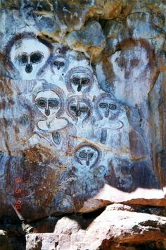 Australia Aboriginal cave art in the Kimberley region.  Fabulous faces/alien helmets?