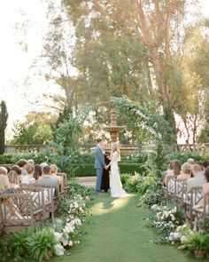 At the end of a grass aisle lined with greenery and white blooms, a handmade arch was draped with acacia, eucalyptus, and delphiniums, then encased in a thicket of ferns. waste wedding decor An Enchanted Garden Wedding in California Wedding Aisles, Wedding Ceremony Ideas, Fern Wedding, Ceremony Decorations, Outdoor Ceremony, Floral Wedding, Wedding Flowers, Dream Wedding, Ceremony Arch