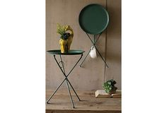 "folding table, green, 15.5"" across, I think. $39"