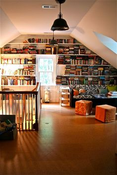 Gorgeous cork floor and library shelving in this attic space