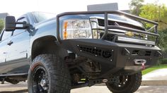 2011 - 2014 Chevy 2500/3500 HoneyBadger Front Rancher bumper Addictive Desert Designs is proud to announce our new line of bumpers: the HoneyBadger Features: Made to mold the front of your truck Two c