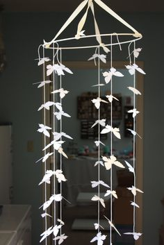 Cute idea, I want to do this but instead of a mobile make a line of them to hang on a wall in the guest room as a room divider