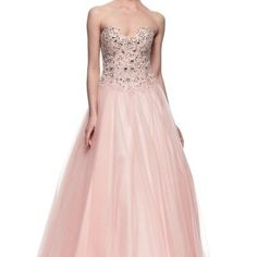 Pink sleeveless prom dress with crystal beaded bodice