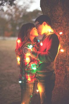 Would love to have a picture of all our kids in lights the pda is optional. lol Cute Christmas photo idea