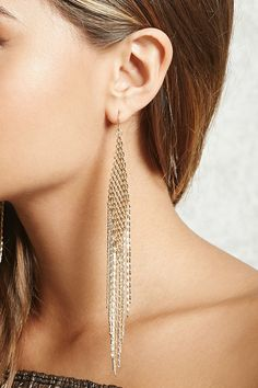 A pair of duster earrings featuring a mesh-style chain design with fringe accents, and fish hook backs.