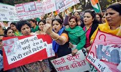 INDIA Protests against the rape of a female Uber passenger in December  2014.