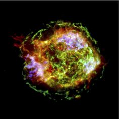 Happy New Year from Cassiopeia A, a supernova remnant. This colorful image, taken by the Chandra X-Ray Observatory in 2009, shows an exploded star 11,000 ly away. The green ring surrounding the supernova is from the initial shock wave generated by the explosion; it measures 10 ly in diameter. The bright blue areas are nearly pure iron gas from the hottest part of the star.