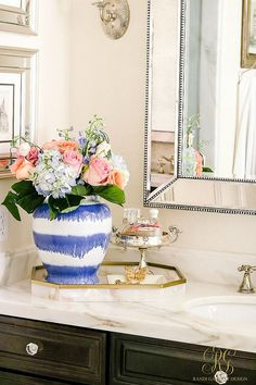 How to Decorate with Ginger Jars in the bathroom and Where to Find them - Randi Garrett Design. Striped blue and white chinoiserie