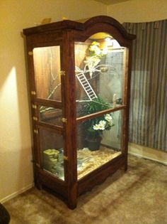 Armoir repurposed into aviary... but instead of this armoire, I'd want a vanishing cabinet!