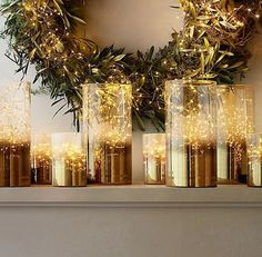 The beauty is multiplied many times over with the lively twinkle of golden lights against the backdrop of a seasonal wreath. Glass vases provide a safe and practical manner to consolidate strands of light for a magnified effect. Set your mantel ablaze in the glow of the holiday season.