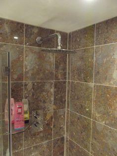 'Dinner plate' shower head and inset dual control shower valve. http://www.ppmsltd.co.uk