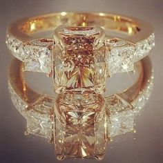 Canary and Bright Brilliant Diamond Engagement Ring. I think I love this the best...but I don't want such a square center diamond.