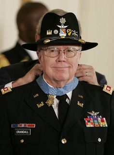 """The U.S. Congressional Medal of Honor, presented by President Bush to Col. Bruce Crandall, a true American hero..also known as  """"Snake 6' which was cut to  """"Snake Shit"""" in the Army...he was portrayed by Greg Kinnear  while flying helos into and out of the """"Valley of Death""""   saving his men in """"We were Soldiers""""...my wife's cousin."""