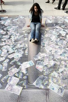 3D pavement art: 24 July 2008: A woman poses in Kurt Wenner's illustration of an open vault