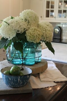 Hydrangeas in canning jars in a canning rack, clever