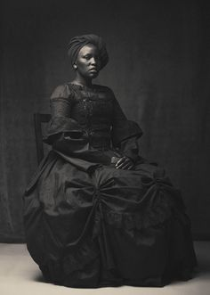 This is Amazing!  It's also a rareity.  I'm always on the lookout for African/African Americans, in Historical Fashion/Costumes!!! I'm glad I have this photograph now!! It's Beautiful!!!:-)!!!