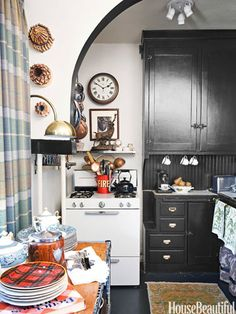 To expand this tiny kitchen, designer Scot Meacham Wood added extra shelves. Cabinetry in Ralph Lauren Paint's Interior Semigloss in Scuba Black.