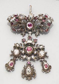 An 18th century ruby and diamond pendant/brooch  Set with lasque-cut diamonds and faceted rubies, to closed back settings, length 6.0cm.