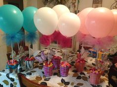 What if we did balloons for the food table. In a bunch but much higher (longer string) Very festive!