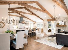 The beams we added throughout the living spaces and master bedroom were actually faux beams, meaning they were hollow. Brittany loved the look of beams, and this was an inexpensive way to achieve the exact same look. ~ Episode season 4 of Fixer*Upper. Estilo Joanna Gaines, Casa Milano, Home Design, Interior Design, Design Ideas, Design Inspiration, Faux Beams, Exposed Beams, Living Room Kitchen