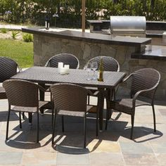 817056015205 Rancho 7 Piece Wicker Outdoor Dining Set Outdoor View