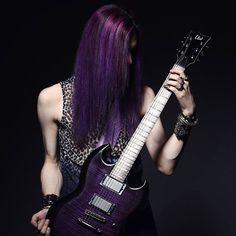 @emilielagerphoto took this badass pic of @patrikbataar from the Swedish Art Metal band, BatAAr. We #love how his #guitar matches his #PurpleHaze #ManicPanic hair. #RockOn!