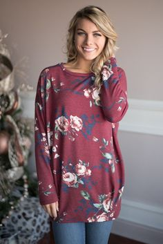 This gorgeous long sleeve floral top is a perfect transition to spring top! Fit: Generous! If you're in between sizes order down. Material: 96% Rayon 4% Spandex Morgan is 5'5'' a size 0 wearing a smal