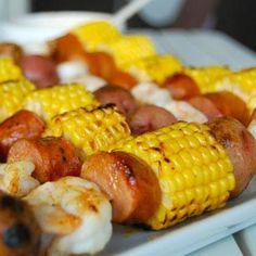 easy summer dinner: shrimp, hot dog (b/c I don't like sausage), corn & potato kebabs.