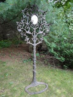 Antique cast iron faux bois hall tree. The hall tree is in antique condition with wear to the finish and rust. The seashell tray and umbrella