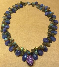 Adorn yourself with exquisite gemstones and look radiant! Blue Tanzanite, green labradorite and purple amethyst Purple Amethyst, Labradorite, Beaded Necklace, Gemstones, Bracelets, Green, Blue, Collection, Jewelry