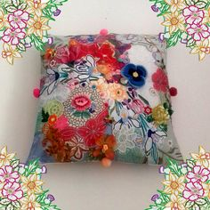 A celebration of vintage, recycled and salvaged textiles this cushion is packed full of embellishment - lace, embroidery, ribbons, flowers, trims and pom poms. An extra special piece to decorate your home and make you smile! Approx 16 inches square Listing is for the cover only, insert