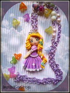 Rapunzel  polymer clay, doll handmade. 5,5cm by IlmondodiSaxStrega.deviantart.com on @deviantART