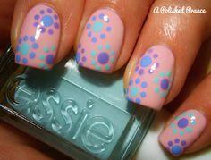 Blue green and purple Polka dot nail art