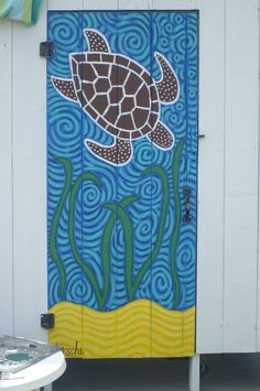 outside shower door at a beach house.