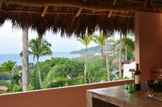 Ocean view at Casita Mimas in Sayulita Mexico, romantic vacation home under a palapa roof with modern, fresh design.
