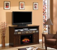 "The Margate multi-function media cabinet with mission style doors, multi-colored slate accents and integrated wire management. Complete with a 26"" ClassicFlame Electric Fireplace insert"