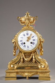 A French 19th century gilded bronze mantel clock with lion heads 1267 : Atena Gallery :French Antiques and Decorative Arts in Paris