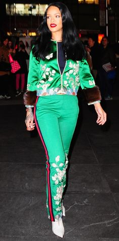 Rihanna epitomized the Gucci girl and tapped her arty-intellectual-sporty side in a green duchesse silk embroidered jacket with fur cuffs and matching green jersey embroidered flared trousers, both by Gucci, and white booties.