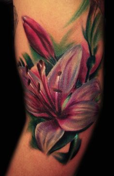 Realistic star gazer lilly tattoo - http://99tattoodesigns.com/realistic-star-gazer-lilly-tattoo/