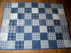 Lovely soft and cuddly blue and white patchwork cot quilt or play mat, the quilt is machined pieced, hand tied and is edged with pale blue binding . Would make a lovely gift. Machine washable at 30 degrees on a gentle cycle do not iron.