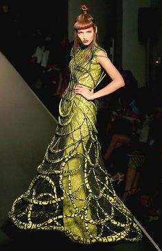 I like how unusual this dress is, it reminds me of something out of a sci fi novel.    #green #cage #dress