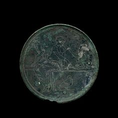 Bronze mirror case with Aphrodite and Pan-Corinthian-around 350 BC-British Museum -
