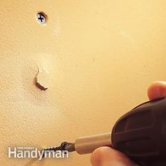 Refasten the drywall with a screws for a permanent fix