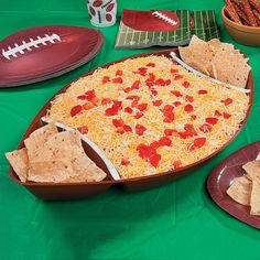 Seven Layer Dip  Layer dip in our Football Tray:  Layer 1: 2 16 oz. cans of refried beans  Layer 2: 1 16 oz. container sour cream  2 avacados  Layer 3: 1 red onion  Layer 4: 1 jalapeno  Layer 5: 10 Roma tomatoes  Layer 6: 1 bundle of cilantro, coursely chopped  Juice of 1 lime  Layer 7: 1- 8 oz. pkg. of Mexican blend cheese  A few diced tomatoes on top as garnish