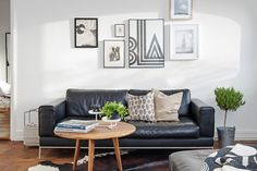 Black sofa with white walls and wooden features